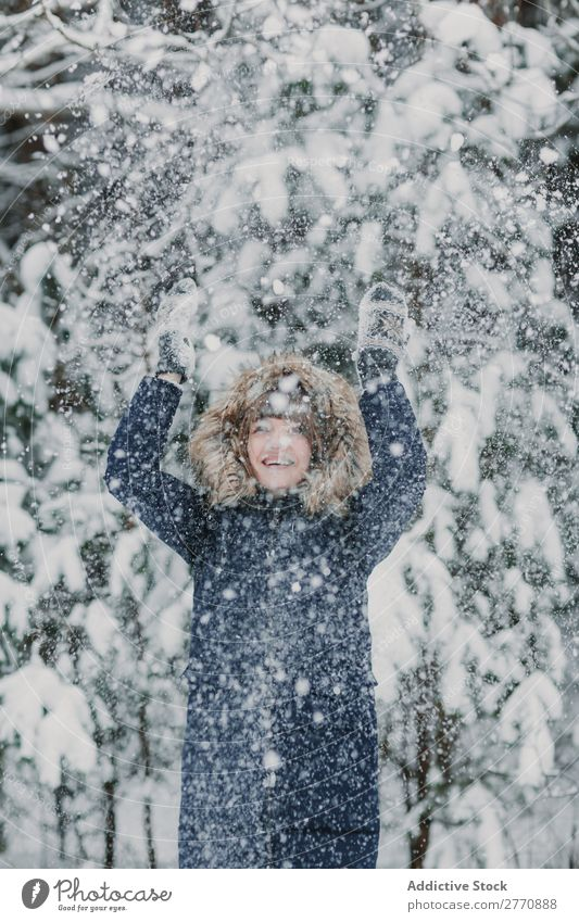 Woman throwing up snow in forest Forest Winter Snow Cold Nature Youth (Young adults) Snowfall White Beautiful Happy Seasons Joy Lifestyle Leisure and hobbies