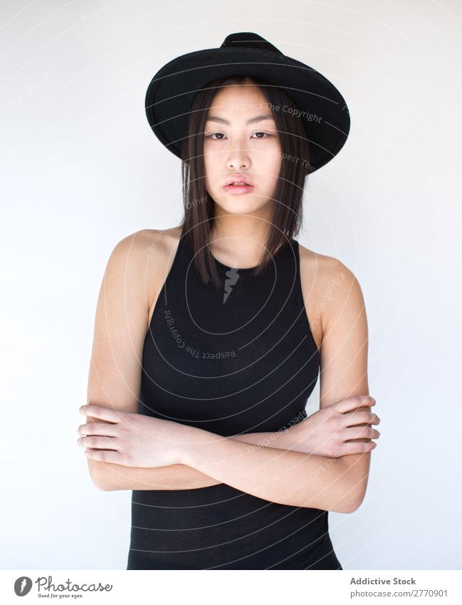 Young Asian woman with arms crossed Woman Style fashionable asian Hat Beautiful Fashion Beauty Photography Youth (Young adults) Model Portrait photograph