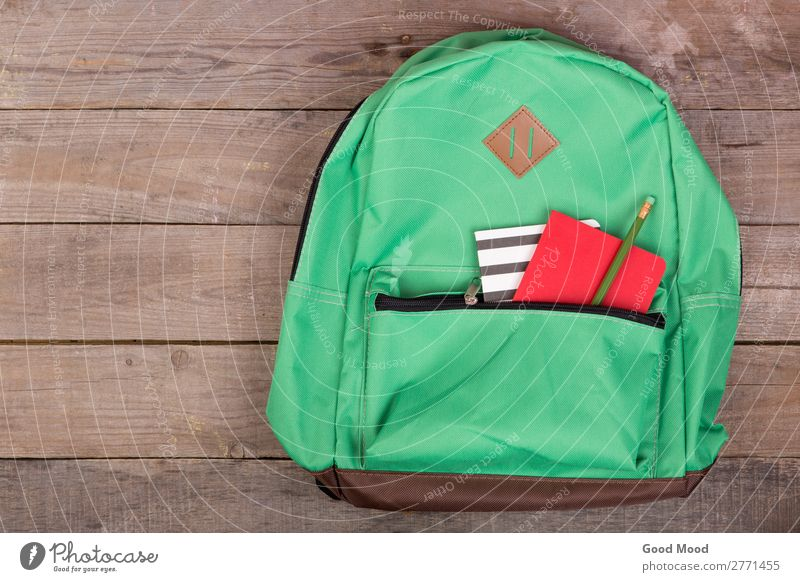Backpack and school supplies: notepad, pencil Table Child School Academic studies Tool Wood Brown Green bag notebook Pencil background education stationery kit