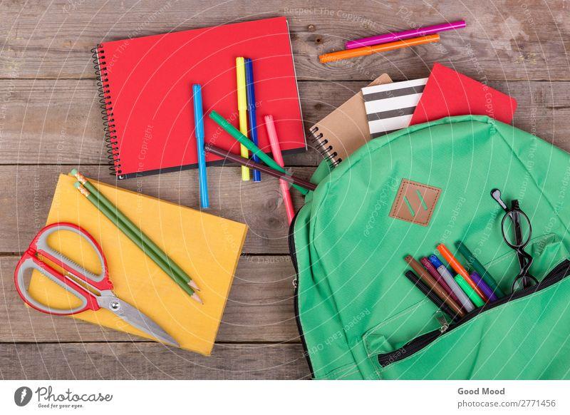 Backpack, books, pencils, notepad, eyeglasses, scissors Table Child School Academic studies Tool Scissors Book Eyeglasses Wood Brown Green bag notebook felt pen