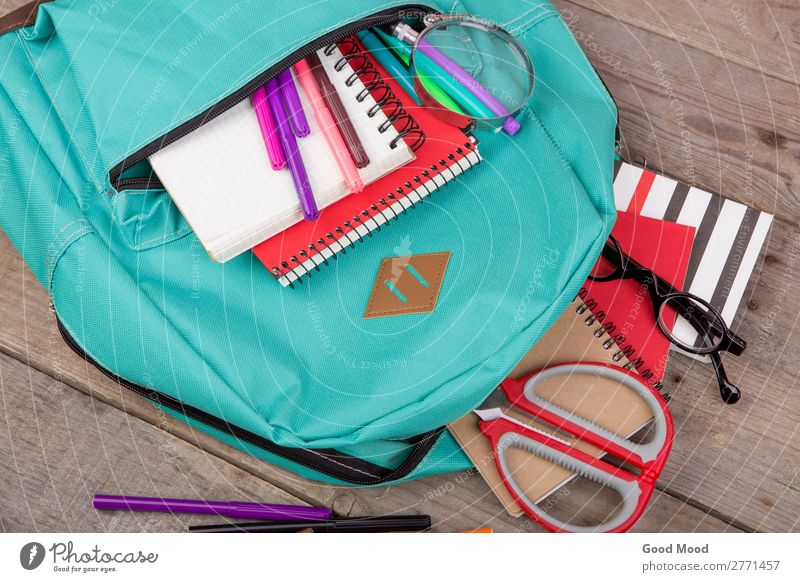 Backpack, magnifying glass, notepad, scissors Table Child School Academic studies Tool Scissors Eyeglasses Magnifying glass Wood Blue Brown bag notebook