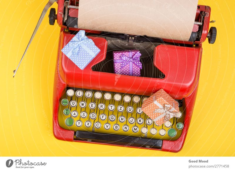 red typewriter with paper, gift boxes on yellow background Feasts & Celebrations Thanksgiving Christmas & Advent Birthday Craft (trade) Business Rope Technology