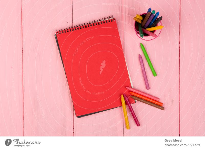 Blank red note pad and crayons on pink wooden table Design Desk Table School Office Business Infancy Art Tie Paper Pen Wood Draw Above Pink Red Colour Crayon
