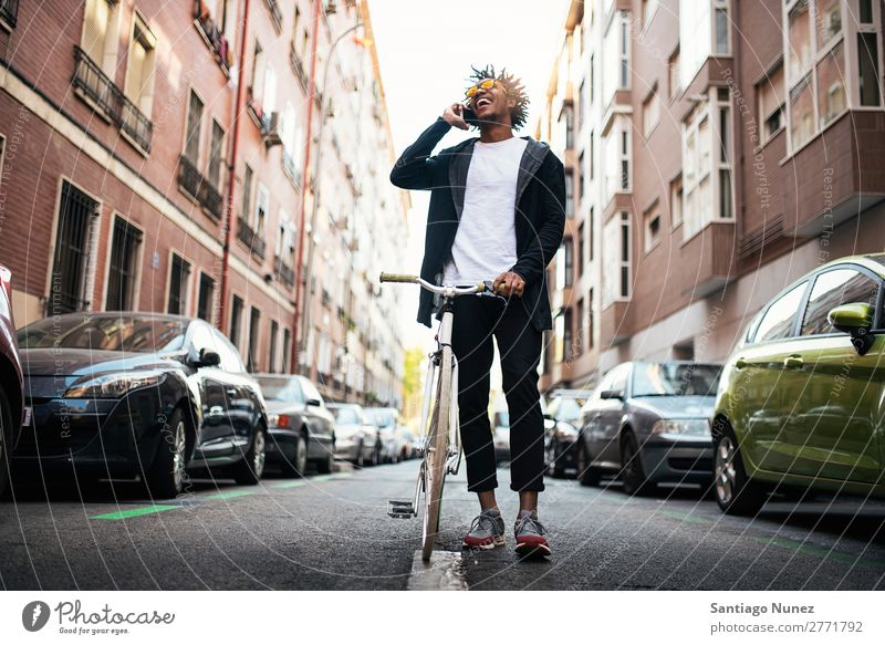 Handsome young man using mobile phone and fixed gear bicycle. Man Youth (Young adults) African Black mulatto Afro Mobile Bicycle fixie Telephone Lifestyle Stand