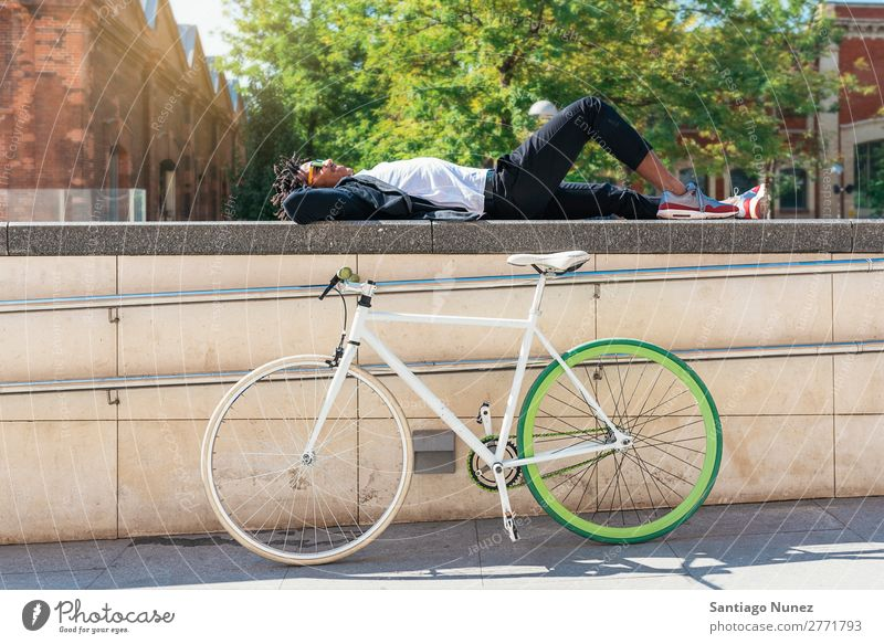 Handsome afro man relaxing near his bike. Man Bicycle fixie Hipster Lifestyle Resting Lie (Untruth) Relaxation enjoying Cycling City Town Human being handsome