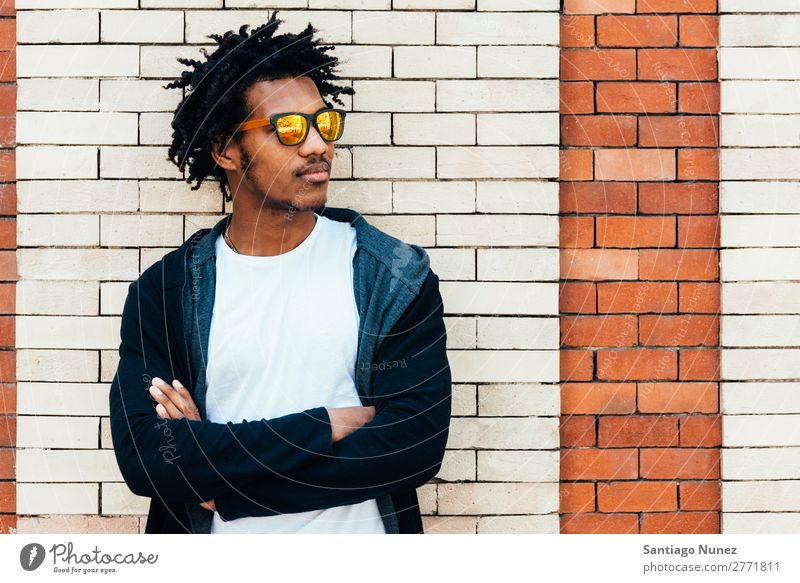 Portrait of handsome afro man Adults Man Youth (Young adults) Portrait photograph African Afro Remorse Earnest cross arms Anger American Attractive