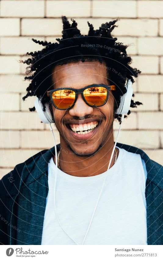 Portrait of afro handsome man listening music. Man Youth (Young adults) African Black mulatto Afro Headphones Mobile Music Listening Telephone Lifestyle Stand
