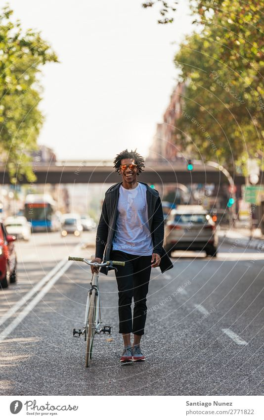 Handsome afro man walking with his bike. Man Youth (Young adults) Afro Black mulatto African Bicycle fixie Hipster Lifestyle Cycling City Town Human being