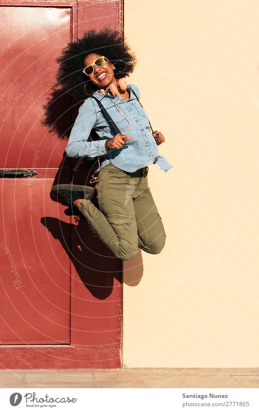 Portrait of beautiful afro american woman jumping. Woman Black African Afro Human being Portrait photograph City Jump Youth (Young adults) Girl American Ethnic