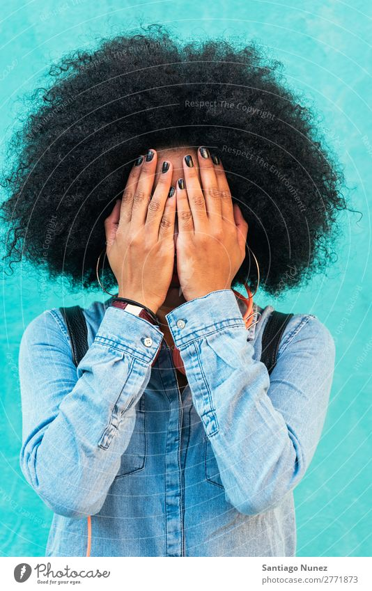 Portrait of beautiful afro woman covering her face. Woman Black African Afro Covered Covering Curly Hand Nail polish Human being Portrait photograph City
