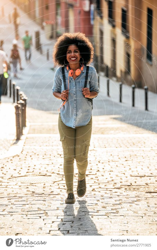Beautiful afro american woman walking. Woman Black African Afro Human being Portrait photograph City Youth (Young adults) Girl American Ethnic Hair Smiling