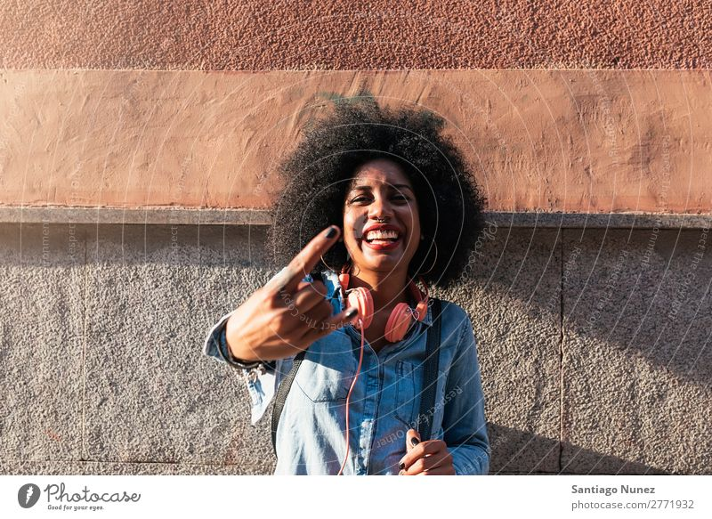Beautiful afro american woman to throw up horns. Woman Black African Afro Human being Portrait photograph Hand Fingers City Youth (Young adults) Girl American