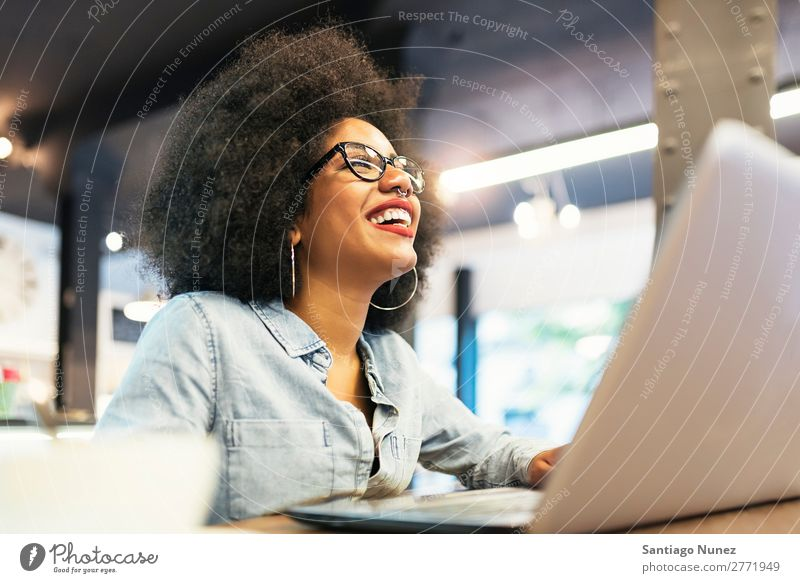 Beautiful afro american woman using mobile and laptop in the coffee shop. Woman Black African Afro Business Businesswoman Cellphone Youth (Young adults)