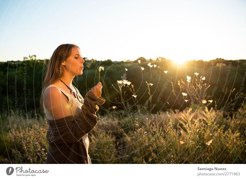 Woman blowing on a dandelion in the park. Portrait photograph Hair Spring Dandelion Hay fever Allergy Blow Pollen allergies Beautiful Natural Background picture