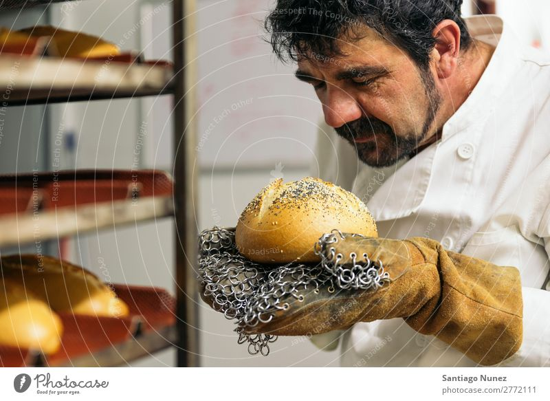 Baker kneading dough in a bakery. Bakery Business staff catering Dough Kitchen Cooking Stand chef Man Food Profession occupation preparing Make Industrial