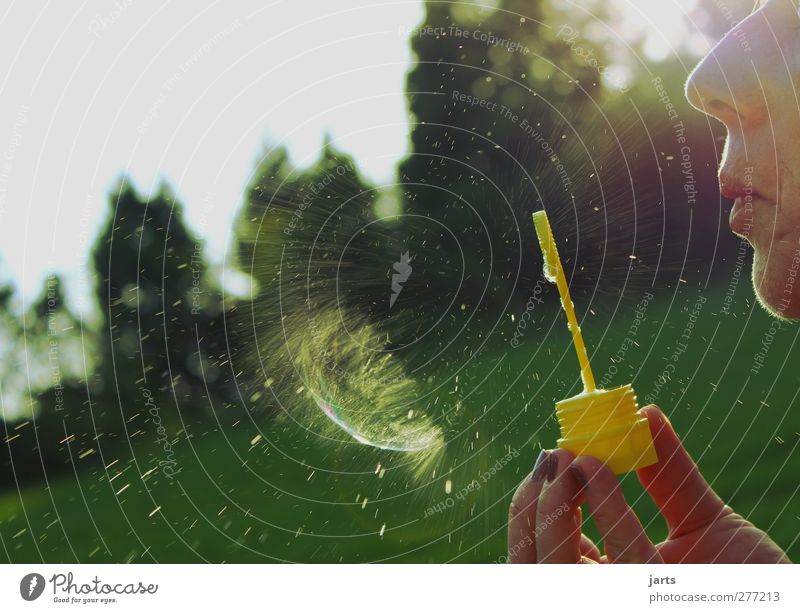 false start Playing Human being Feminine Mouth 1 Tree Meadow Life Soap bubble Blow Bursting Drops of water Snap Colour photo Exterior shot Close-up Detail