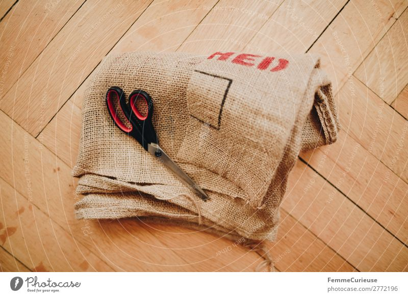 Upcycling - making garments from coffee bag Lifestyle Sustainability bean bag Scissors Parquet floor Sewing cut Recycling upcycling Colour photo Interior shot