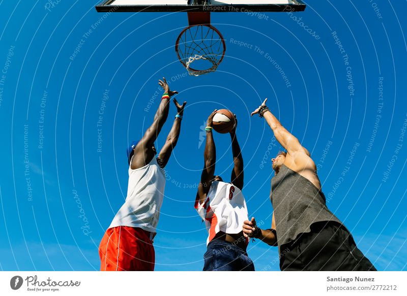 Friends playing basketball in court. Basketball Playing Friendship Youth (Young adults) Court building Group Ball Man Team Sports Human being Exterior shot 3