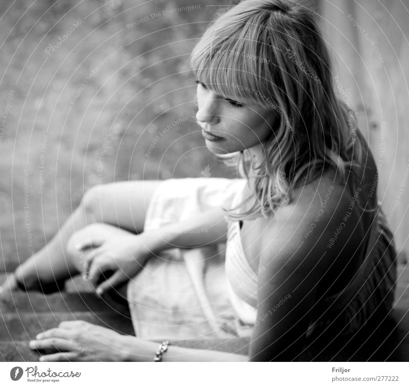 . Feminine Young woman Youth (Young adults) Adults 1 Human being 18 - 30 years Observe Looking Sit Dream Sadness Wait Black & white photo Exterior shot Day