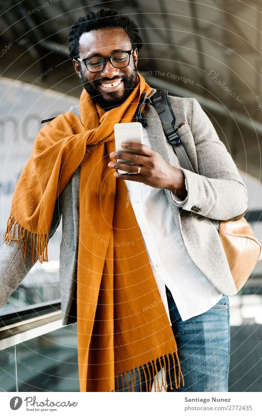 Businessman in the Train Station. Man Black African American Cellphone Youth (Young adults) Telephone Happy Mobile Interior shot Street PDA Office Human being