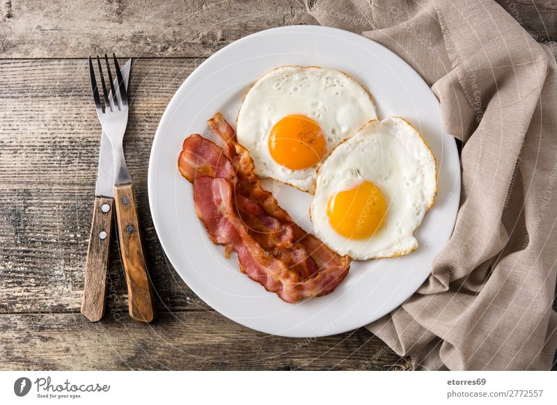 Fried eggs and bacon for breakfast on wood Healthy Eating Food photograph Dish Tradition Breakfast Egg Plate Dinner Meal English American Tasty British