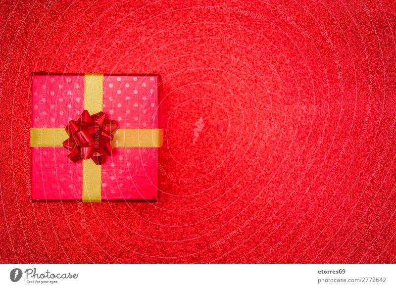 Christmas red gift presents on red glitter background. Vacation & Travel Christmas & Advent Red Feasts & Celebrations Gift Paper Public Holiday Box Carton