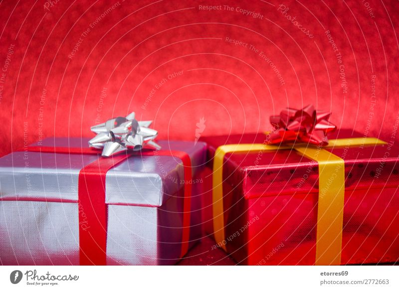 Christmas gifts presents on red glitter background Vacation & Travel Christmas & Advent Red Feasts & Celebrations Gift Paper String Public Holiday Box Silver