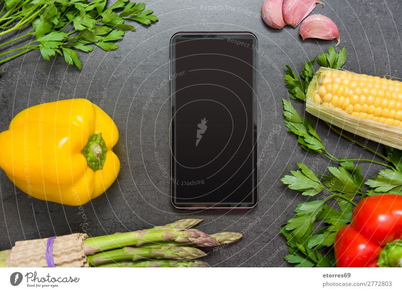 vegetables and mobile phone on slate table Neutral Background Food Healthy Eating Food photograph Asparagus Black Dark Slate Carrot Gray Fresh Cooking market