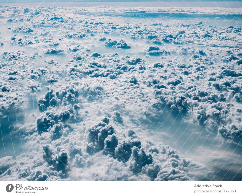 Fluffy clouds in sunlight Clouds Sunlight Sky Cumulus Landscape Haze Climate Environment Light cloudscape Bright Universe Beauty Photography Nature Atmosphere