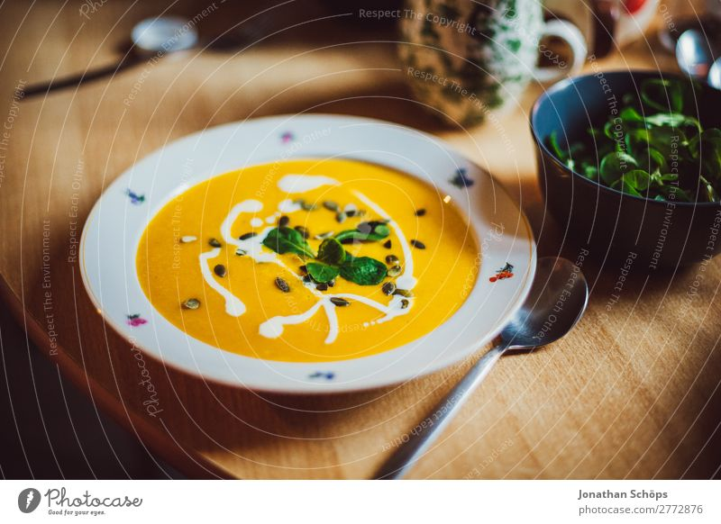 Pumpkin soup on the plate Food Lettuce Salad Soup Stew Nutrition Eating Lunch Vegetarian diet Healthy Healthy Eating Contentment Living or residing