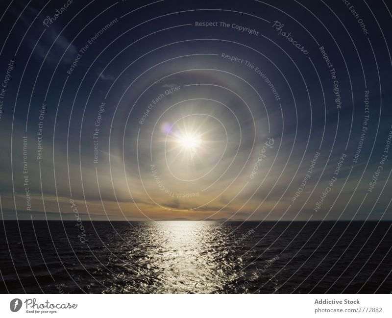 Sun phenomenon above sea Ocean Sunlight Panorama (Format) Water Phenomenon Background picture Halo Landscape Horizon Morning Paradise tranquil Seasons