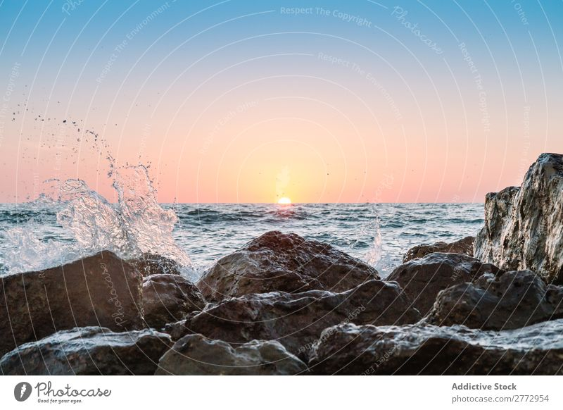 Water dashing against rocks Rock Ocean Sunset splashes Landscape Dramatic Summer magical Vacation & Travel Coast Transparent Panorama (Format) Natural