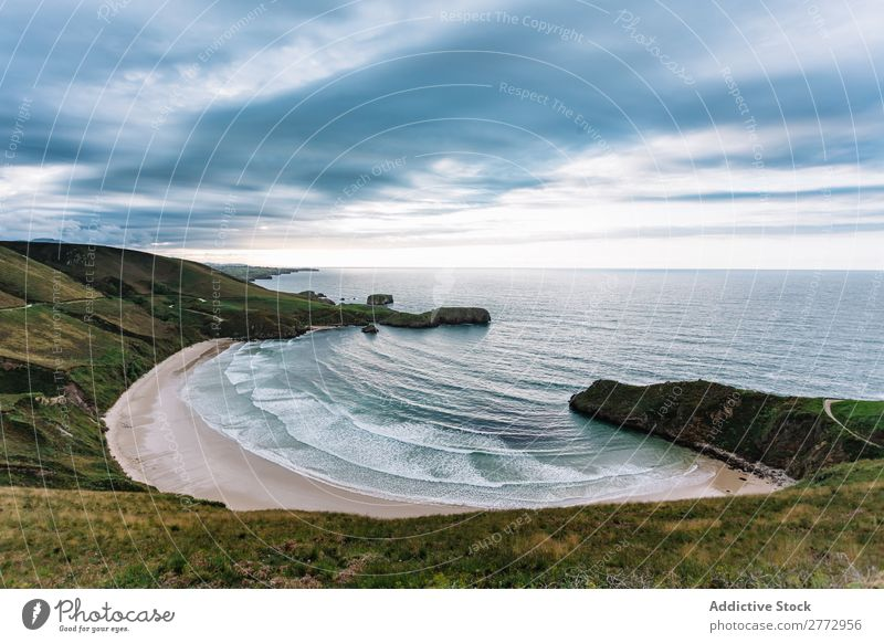 Ocean lagoon in cliff formation Coast Lagoon Cliff Landscape Turquoise Wilderness Cloud cover scenery Calm seaside Dramatic Deserted Vacation & Travel Summer