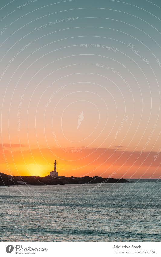 Seashore with lighthouse in sunset Ocean Coast Lighthouse Sunset Navigation Nature Beauty Photography Landscape Dramatic Sunrise Vacation & Travel Sky Tourism