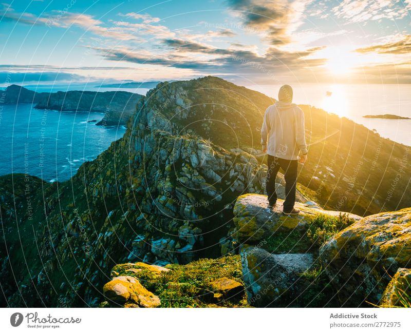 Traveler posing on amazing landscape Man traveler Panorama (Format) Ocean Rock Mountain Sunlight Virgin forest Dream Nature exploration Perspective Picturesque