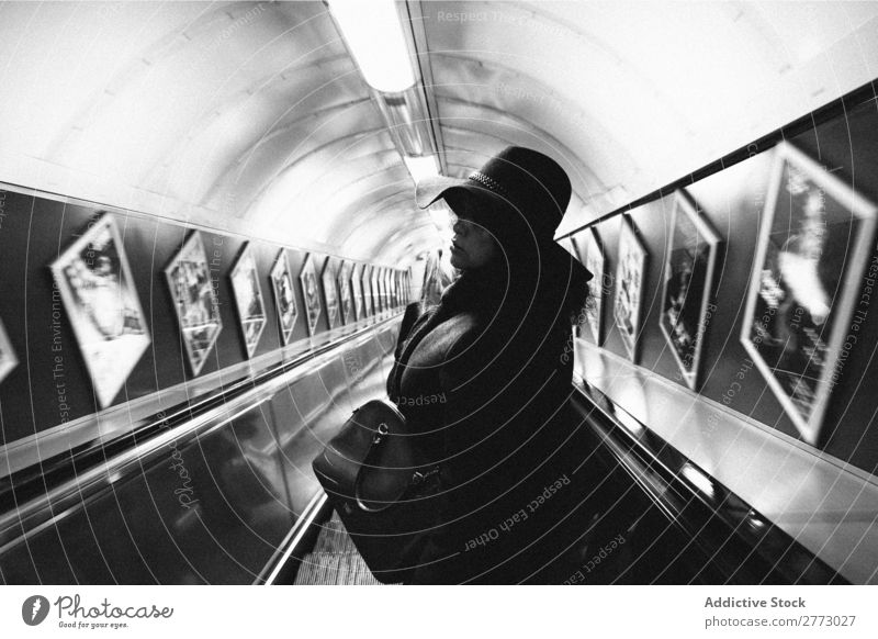 Woman in subway. Adults Underground Interior design Descend Escalator center City Movement Downward Passenger Human being Perspective Public Stairs Station
