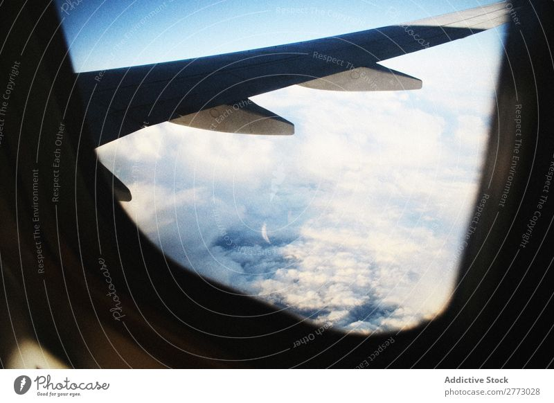 Wing of plane in the air Airplane illuminator Story Porthole Window Height Sky aerospace Earth Vantage point Fly Vacation & Travel Jet Engines Transport Blue