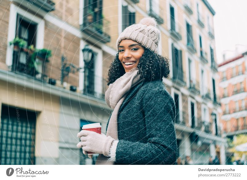 Young black woman drinking coffee wandering in the streets of Madrid on winter Woman Vacation & Travel City Town center Spain Exterior shot Student Cute Street