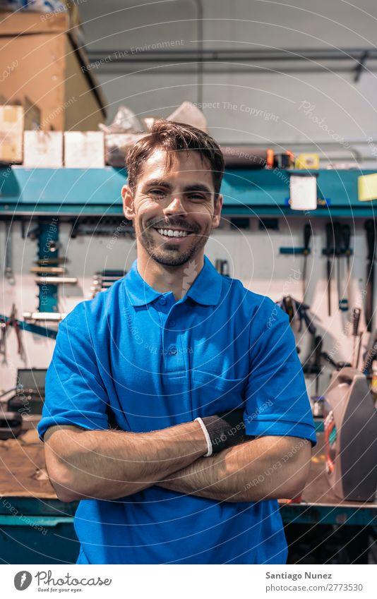 Portrait of Car Mechanic Man Portrait photograph portraiture Wall (building) Smiling Friendliness Background picture Tool varierty Blacksmith Board Box