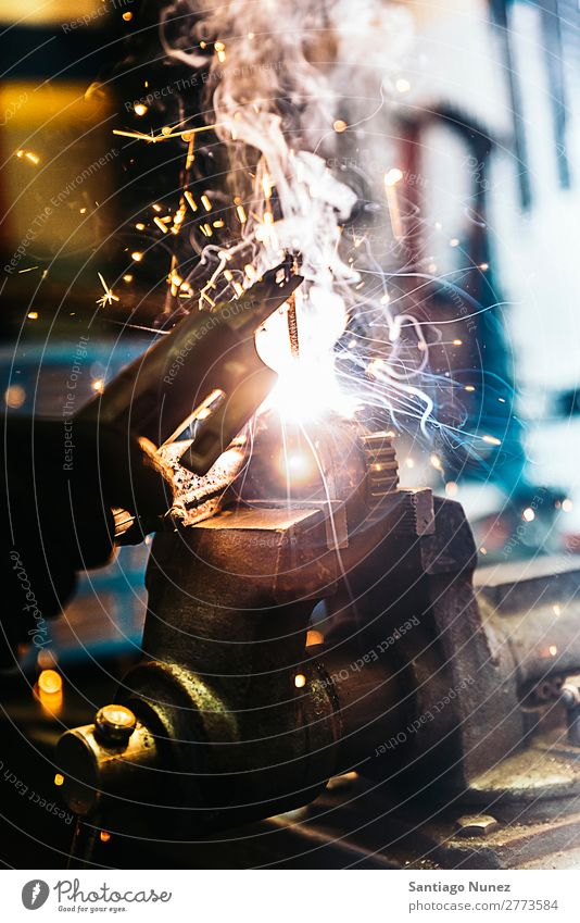 Mechanic man welding metal material in garage. Tool Trade Welder Welding Employees & Colleagues Gas burner Caucasian Craft (trade) Craftsman Faceless