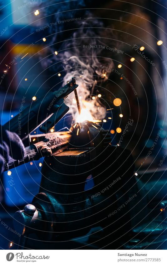 Mechanic man welding metal material in garage Tool Trade Welder Welding Employees & Colleagues Gas burner Caucasian Craft (trade) Craftsman Faceless