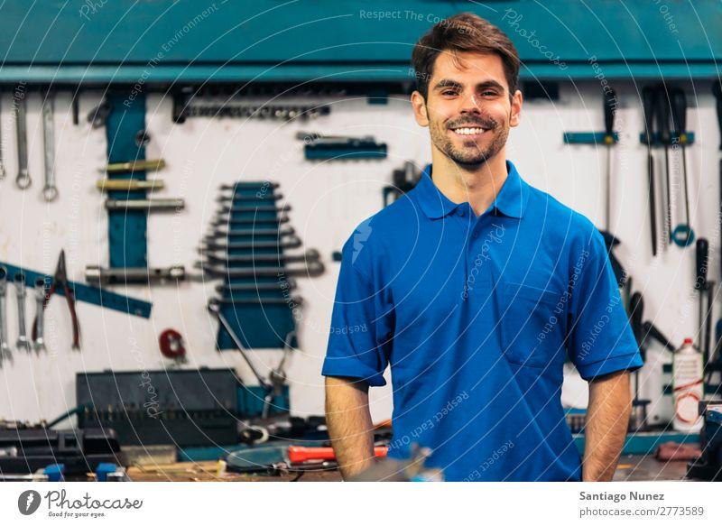 Portrait of Car Mechanic Man. Portrait photograph portraiture Wall (building) Smiling Friendliness Background picture Tool varierty Blacksmith Board Box