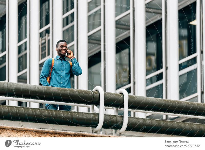 Businessman in the Street. Man Black African American Cellphone Youth (Young adults) Telephone Happy Mobile Exterior shot PDA Office Human being Communication