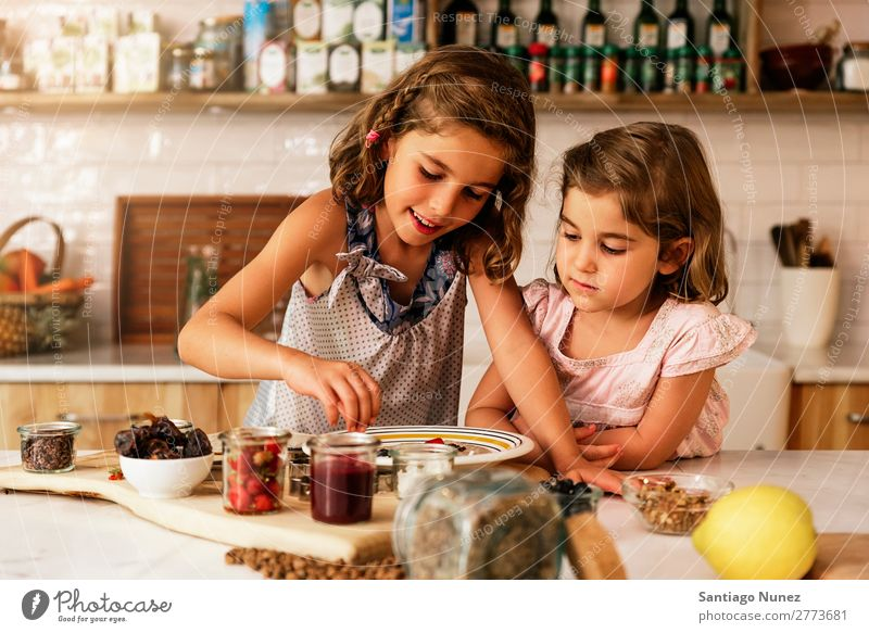 Little sisters girl preparing baking cookies. Child Girl Cooking Kitchen Chocolate Ice cream Daughter Day Happy Joy Family & Relations Love