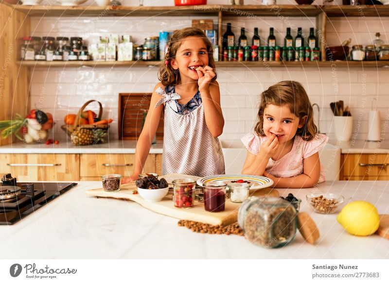 Little sisters girl preparing baking cookies. Child Girl Cooking Kitchen Chocolate Eating savoring Strawberry Daughter Day Happy Joy Family & Relations Love