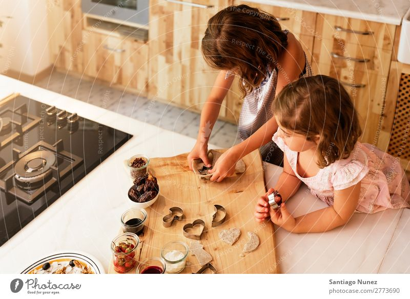 Little sisters girl preparing baking cookies. Child Girl Cooking Kitchen Chocolate Ice cream Strawberry Daughter Day Happy Joy Family & Relations Love