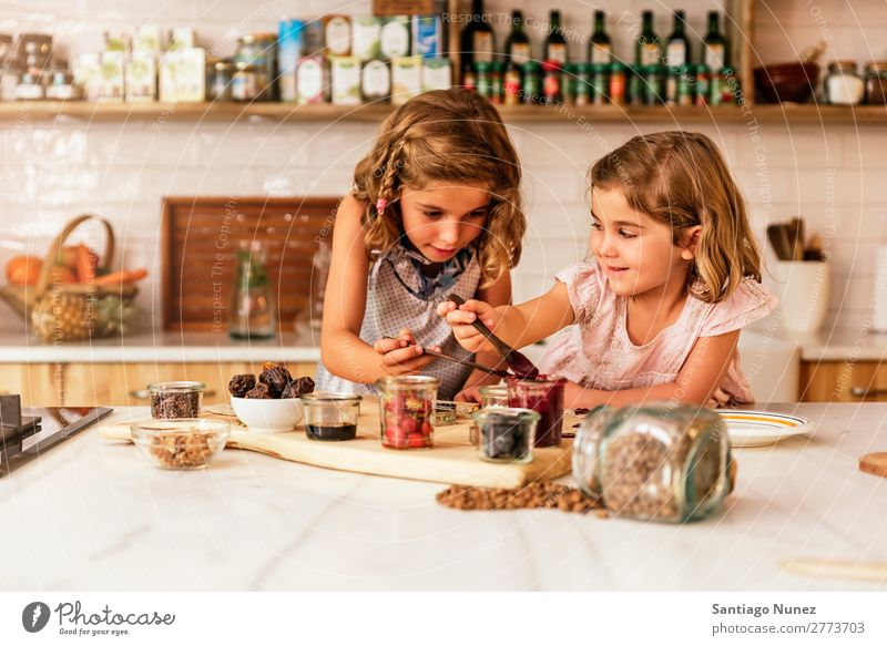 Little sisters girl preparing baking cookies. Child Girl Cooking Kitchen Chocolate Ice cream Strawberry Daughter Day Happy Joy Family & Relations Love Pizza