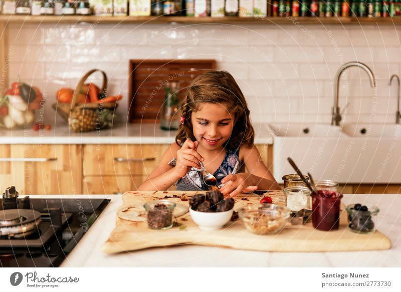 Portrait of little girl preparing baking cookies. Girl Child Nutrition Portrait photograph Cooking Kitchen Appetite Preparation Make Smiling Laughter Lunch Baby