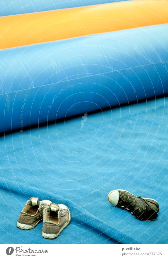 air cushions Footwear Sneakers Plastic bouncy castle Floor mat Colour photo Exterior shot Deserted Day Section of image