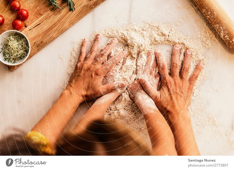 Little girl kneading flour with her mother. Child Girl Hand Mother Cook Cooking Kitchen Flour Dough Daughter Day Happy Joy Family & Relations Love Baking Food